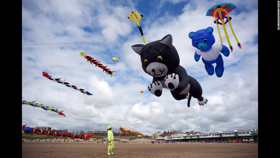 Kite enthusiasts participate in the St. Annes Kite Festival in Lytham St. Annes, England, on Saturday, July 30.
