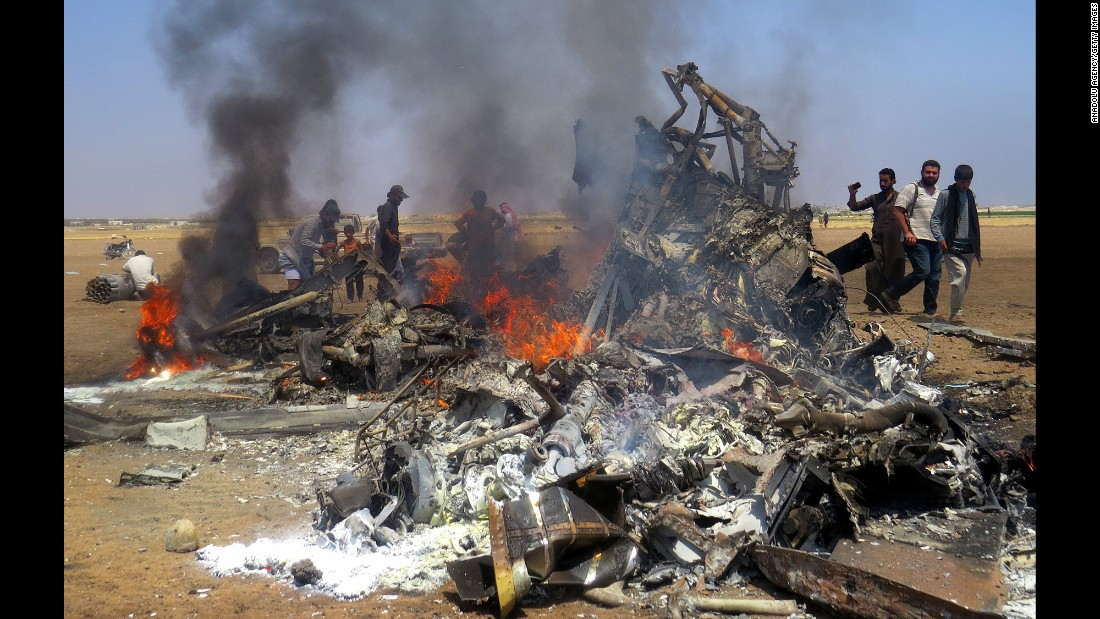 "People gather around the burning wreckage of a Russian helicopter <a href=""http://www.cnn.com/2016/08/01/middleeast/syria-aleppo/"" target=""_blank"">that was shot down</a> on Monday, August 1, killing all five people on board. The helicopter was delivering aid to the city of Aleppo, Russian state media reported. It was the biggest loss of life for Russia in Syria since Russian warplanes started carrying out airstrikes in the war-ravaged country in September."