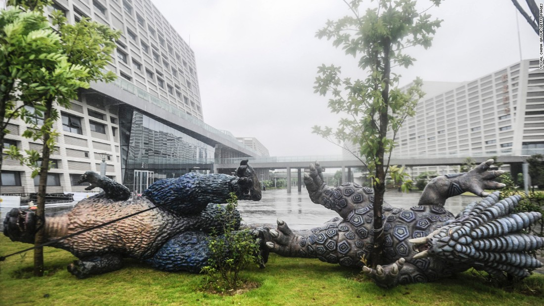 Monster sculptures were taken down and tied to trees before Typhoon Nida landed in Dongguan, China, on Tuesday, August 2.
