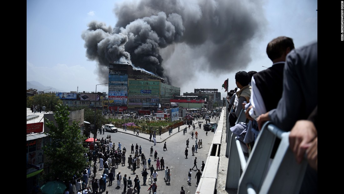 A fire rages at a shopping mall in Kabul, Afghanistan, on Thursday, August 4. The cause of the fire was not immediately known.