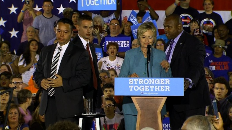 Secret Service agents jump on stage at Clinton rally