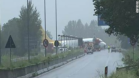 A cargo plane skidded off the runway and into the road at the Bergamo Orio al Serio Airport in Italy.