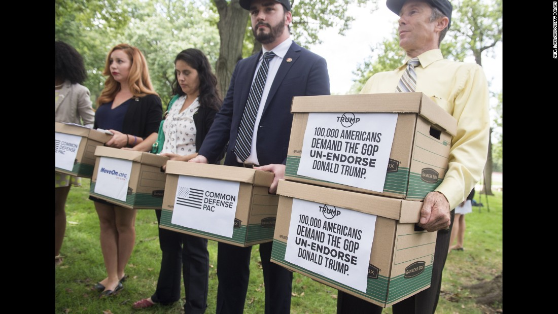 U.S. veterans in Washington carry boxes Thursday, August 4, to symbolize a petition that calls for Republican leaders to withdraw their endorsement of presidential candidate Donald Trump. The petition's signatures were actually delivered electronically.