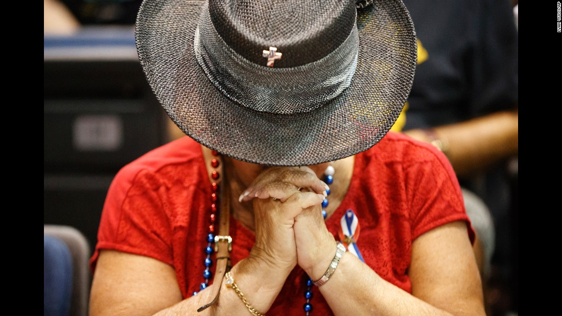 A Donald Trump supporter prays during a campaign event in Daytona Beach, Florida, on Wednesday, August 3.