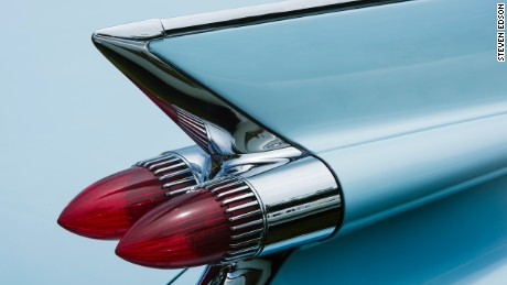 Horizontal color detail photograph of the rear fin and tail light of a 1959 Cadillac Series 62 Convertable with Breton blue paint. Photographed at the 2016 Greenwich Concours d'Elegance. Greewich, CT.