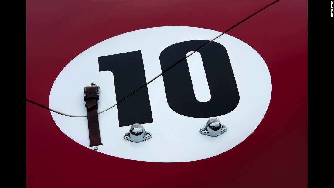 The rear trunk of a 1961 Ferrari 250 Tri/61 Spyder. It has a leather hood clasp and lights to illuminate the No. 10.