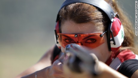 Lebanese Trap Champion Ray Bassil gives a thumbs-up sign as she trains for the 2012 Summer Olympic Games in London at a shooting club in Ghadras north of Beirut on July 13, 2012. AFP PHOTO/JOSEPH EID        (Photo credit should read JOSEPH EID/AFP/GettyImages)