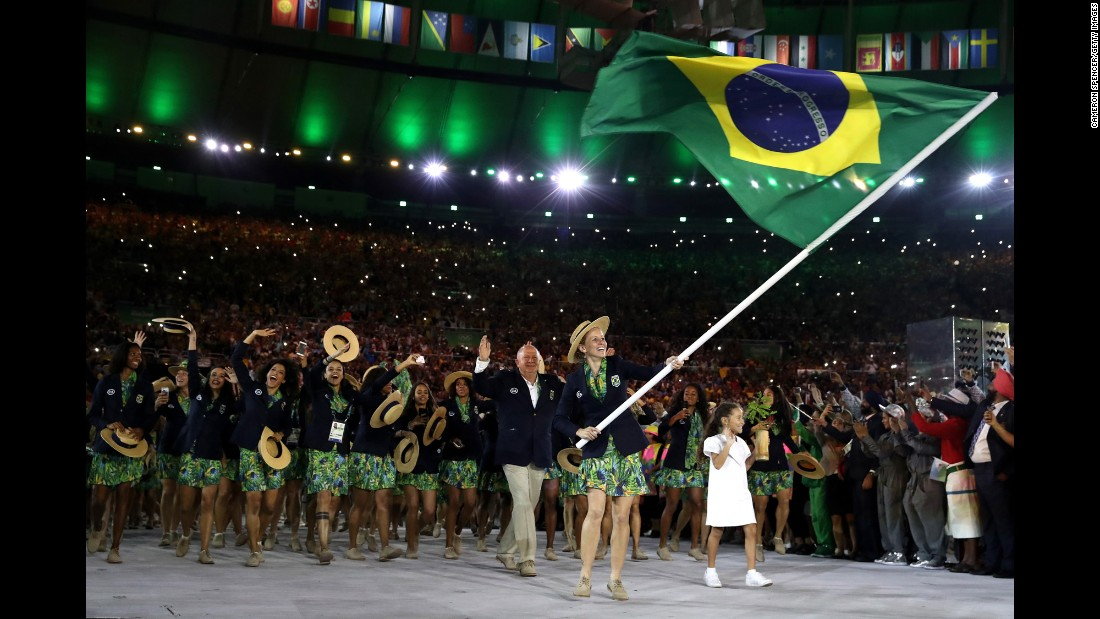 Pentathlete Yane Marques leads Brazil's athletes into the Maracana Stadium.