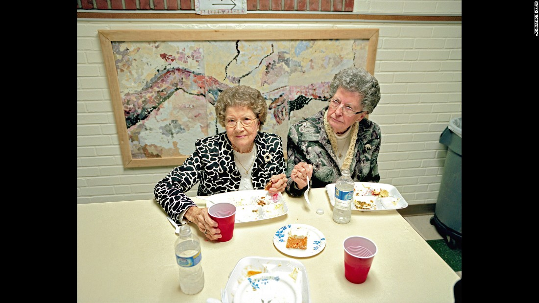 Two sisters eat as they attend a Sacred Harp gathering in Ephesus, Georgia.
