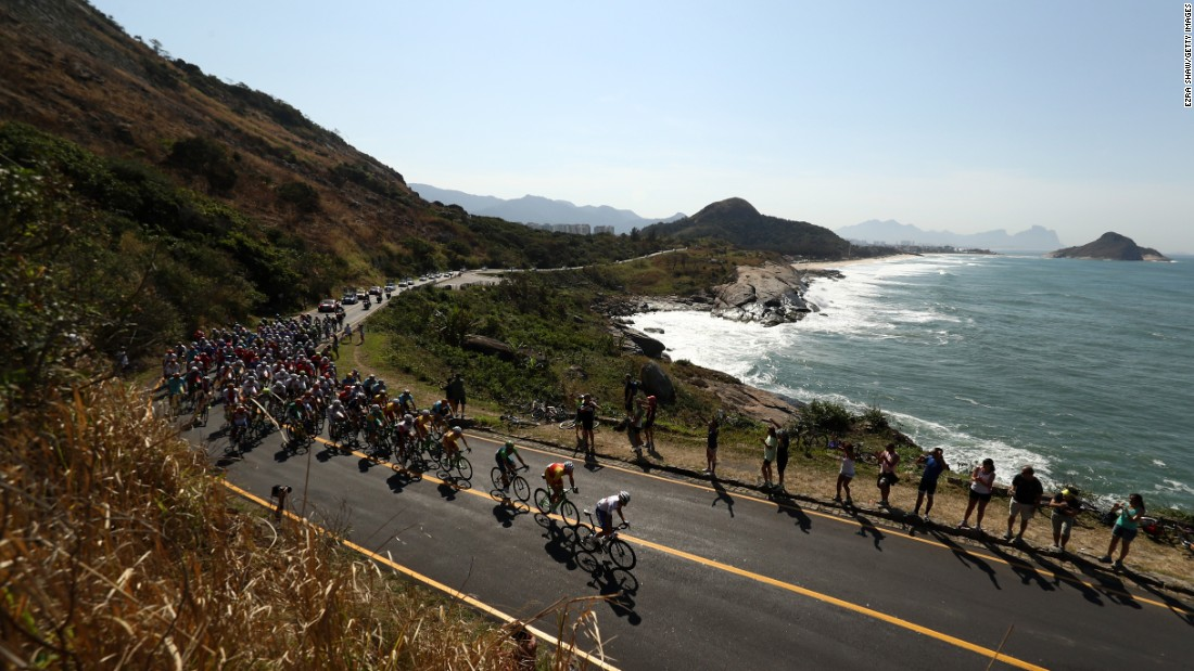 The peleton passes through Grumari during the men's road race in cycling. The race began at Fort Copacabana.