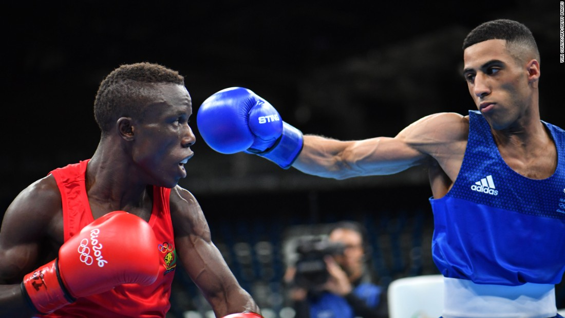 Great Britain's Galal Yafai, right, punches Cameroon's Fotsala Simplice during the men's light fly match.