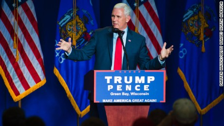 Republican vice presidential candidate, Indiana Gov. Mike Pence greets the crowd before introducing Republican presidential candidate Donald Trump at a rally on August 5, 2016 in Green Bay, Wisconsin.