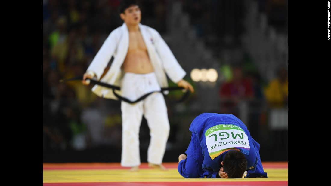 Tsogtbaatar Tsend-Ochir of Mongolia, right, reacts after being defeated by Kim Won-Jin of Republic of Korea in the men's 60kg judo.