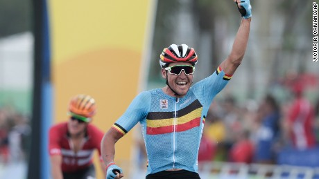 Greg van Avermaet celebrates after crossing the finish line to win the men's cycling road race.