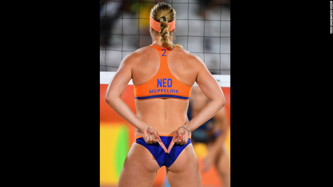 Madelein Meppelink of the Netherlands signals during the women's beach volleyball preliminary round Pool F match against Olaya Perez Pazo and Norisbeth Agudo of Venezuela. Meppelink and teammate Marleen van Iersel won 21-17, 21-11.