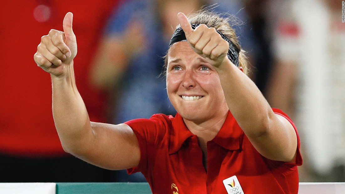 Belgium's Kirsten Flipkens cries after defeating Venus Williams of the United States in the women's tennis competition 4-6, 6-3, 7-6.
