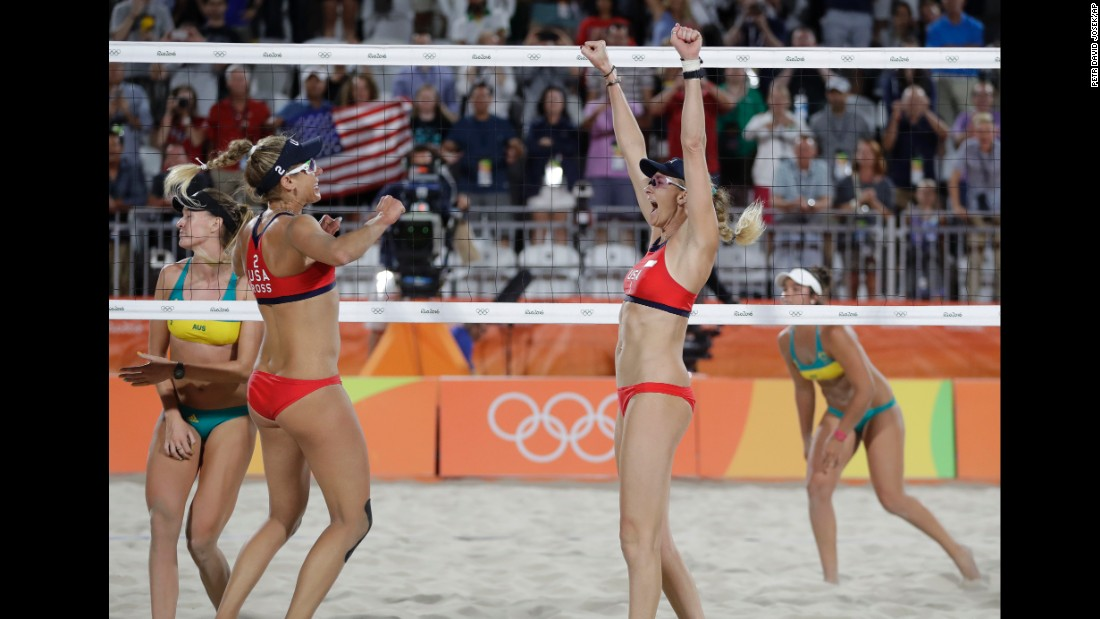 Kerri Walsh Jennings celebrates with her teammate April Ross after winning a beach volleyball match against Australia, 21-14, 21-13, at the 2016 Summer Olympics in Rio de Janeiro, Brazil, early in the morning on Sunday August 7.