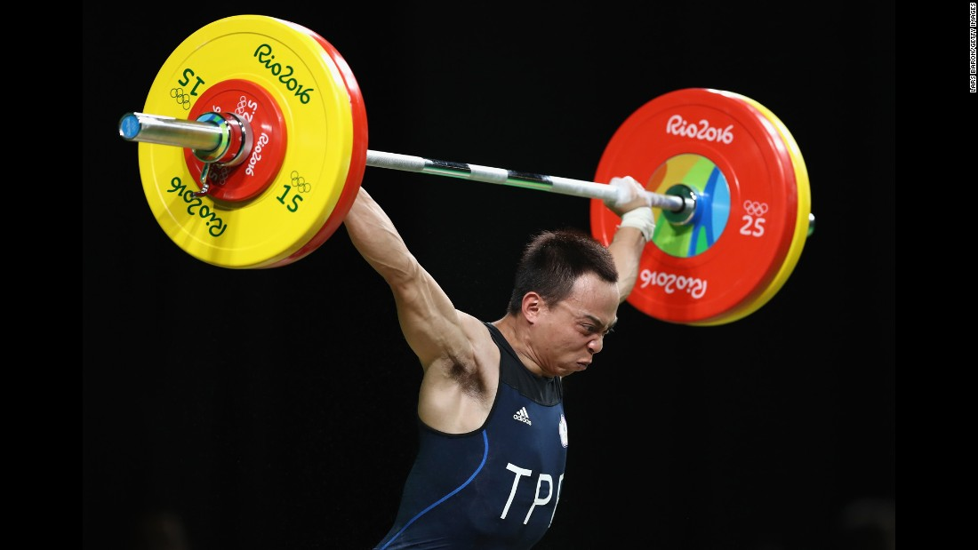 Chi-Chung Tan of Chinese Taipei competes during the men's 53kg Group A weightlifting contest.