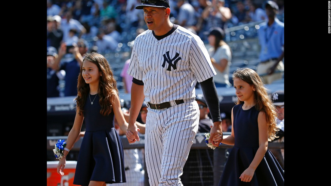 Rodriguez walks onto the field with his daughters, Natasha, left, and Ella, for a pregame ceremony on September 13, 2015 celebrating his 3,000th career hit.