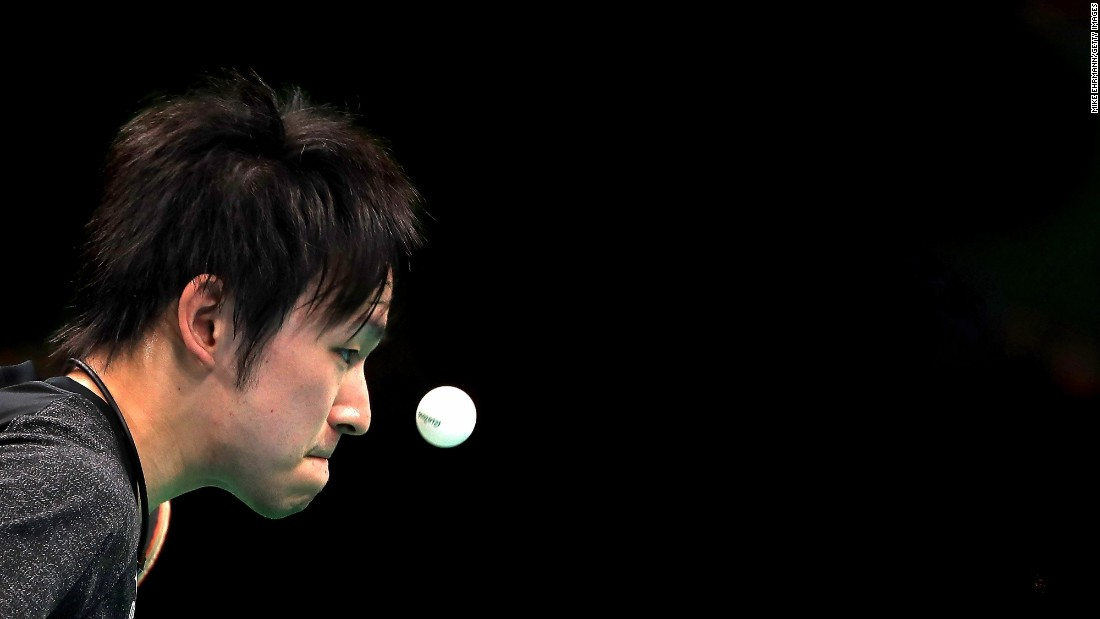 Koki Niwa of Japan is focused on the ball during his men's singles table tennis match match against Segun Toriola of Nigeria.