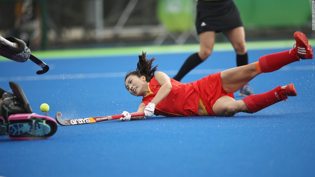 Li Hongxia falls after diving to shoot at goal as China loses 4-1 in its women's field hockey match against Germany.
