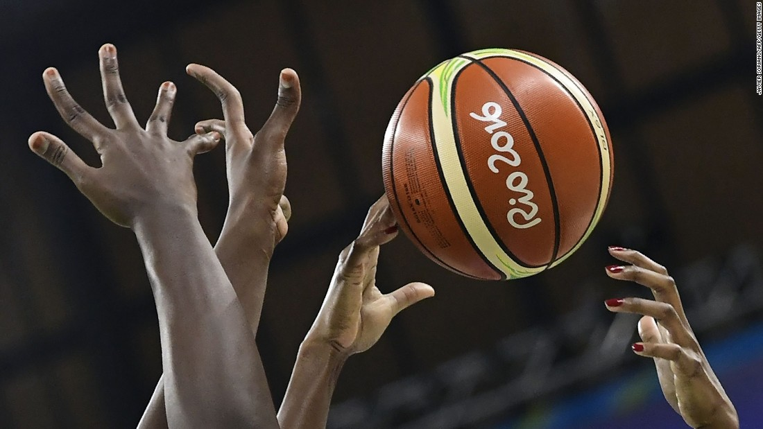 "Players reach out to the ball during the women's basketball match between USA and Senegal. The Americans won 121-56, <a href=""http://edition.cnn.com/2016/08/02/sport/team-usa-womens-basketball-rio-2016/index.html"" target=""_blank"">setting a new record </a>for the most points scored in Olympic history."