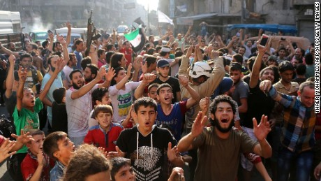 Syrians in Aleppo celebrate in the streets