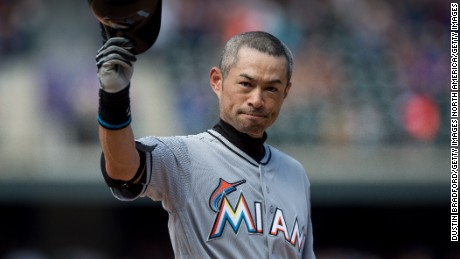Ichiro Suzuki of the Miami Marlins tips his hat to the crowd after hitting a seventh inning triple against the Colorado Rockies for the 3,000th hit of his MLB career.