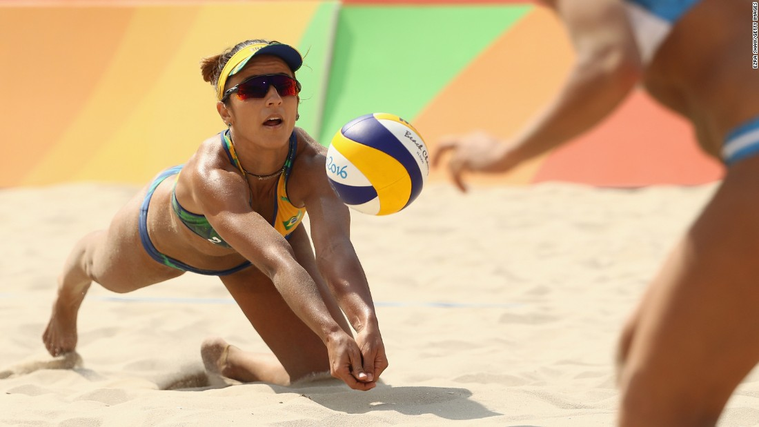 Agatha Bednarczuk of Brazil dives during a beach volleyball match against Ana Gallay and Georgina Klug of Argentina.
