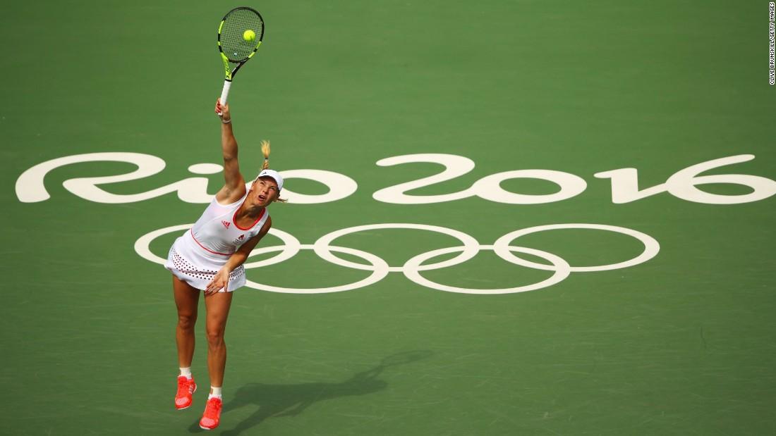 Denmark's Caroline Wozniacki serves during her second-round match against Petra Kvitova of the Czech Republic. Kvitova advanced with a 6-4, 6-2 victory.