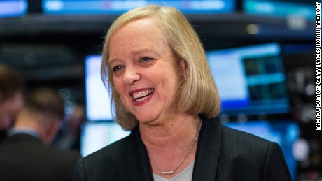 Meg Whitman, CEO of Hewlett Packard, gives a television interview on the floor of the New York Stock Exchange after ringing the opening bell on November 2, 2015 in New York City.