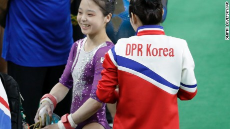 South Korea's Lee Eun-ju, left, smiles as she talks with North Korea's Hong Un Jong during the artistic gymnastics women's qualification at the 2016 Summer Olympics in Rio de Janeiro, Brazil.