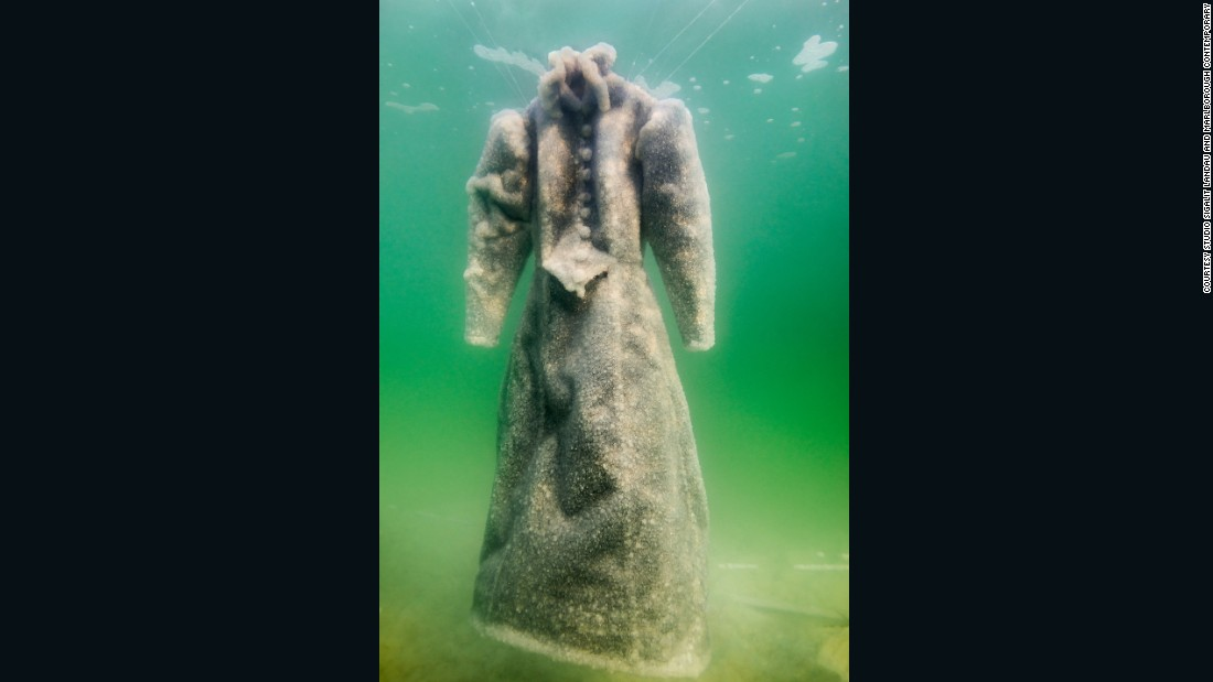"In her ""Salt Bride"" photography series, Israeli artist Sigalit Landau documents how a dress transformed over three months being submerged in the Dead Sea."