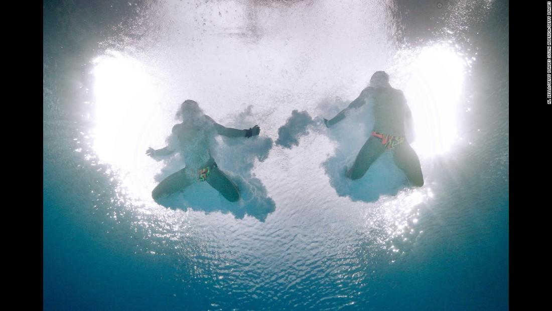 Ukrainian synchronized divers Maksym Dolgov and Oleksandr Gorshkovozov compete in the 10-meter platform final.