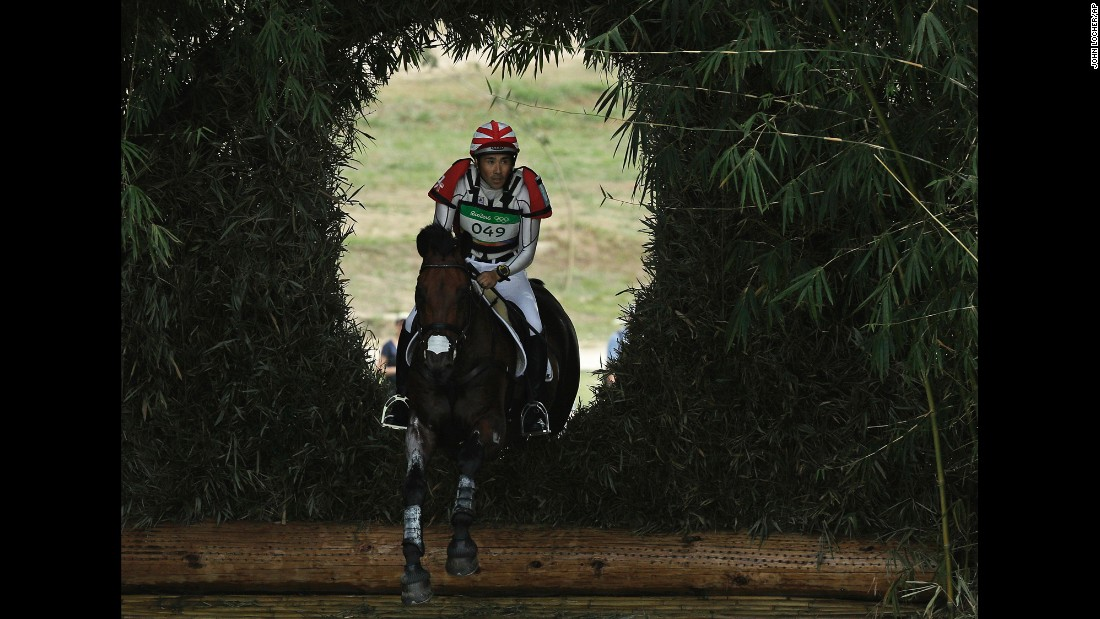 Japanese rider Yoshiaki Oiwa, on The Duke of Cavan, competes in the cross-country phase of the eventing competition.