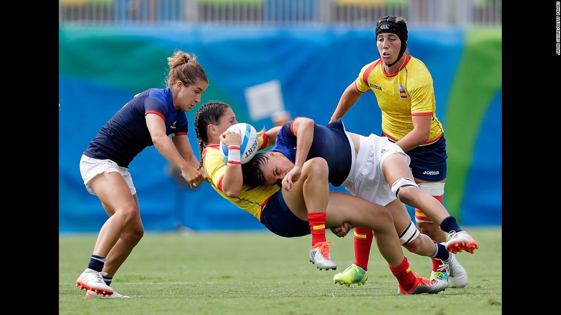 Amaia Erbina of Spain is tackled by Audrey Amiel and Pauline Biscarat of France during a rugby sevens match.