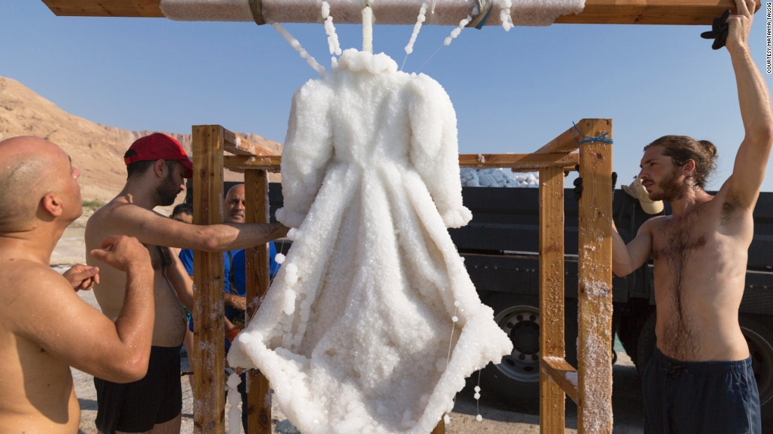 Dresses transformed by salt crystals have been pulled from the depths of the Dead Sea salt lake.