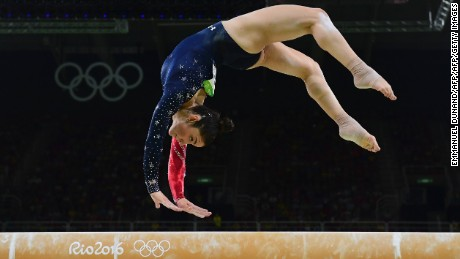 US gymnast Alexandra Raisman competes in the qualifying for the women's Beam event of the Artistic Gymnastics at the Olympic Arena during the Rio 2016 Olympic Games in Rio de Janeiro on August 7, 2016. / AFP / Emmanuel DUNAND        (Photo credit should read EMMANUEL DUNAND/AFP/Getty Images)