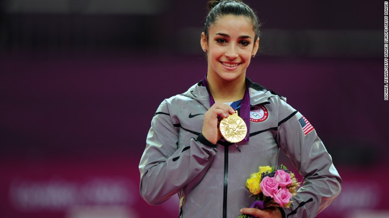 Aly Raisman displays her gold medal for the women's floor exercise during