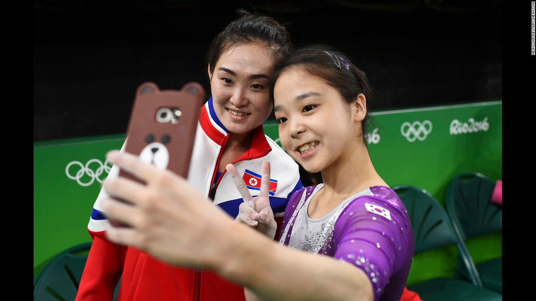 "South Korean gymnast Lee Eun-ju <a href=""http://www.cnn.com/2016/08/08/sport/korea-gymnast-selfie/index.html"" target=""_blank"">takes a selfie</a> with North Korean gymnast Hong Un-jong during training. Relations have been frosty between the North and South since its division following the end of World War II, but geopolitics were put to the side as the two Olympians came together."