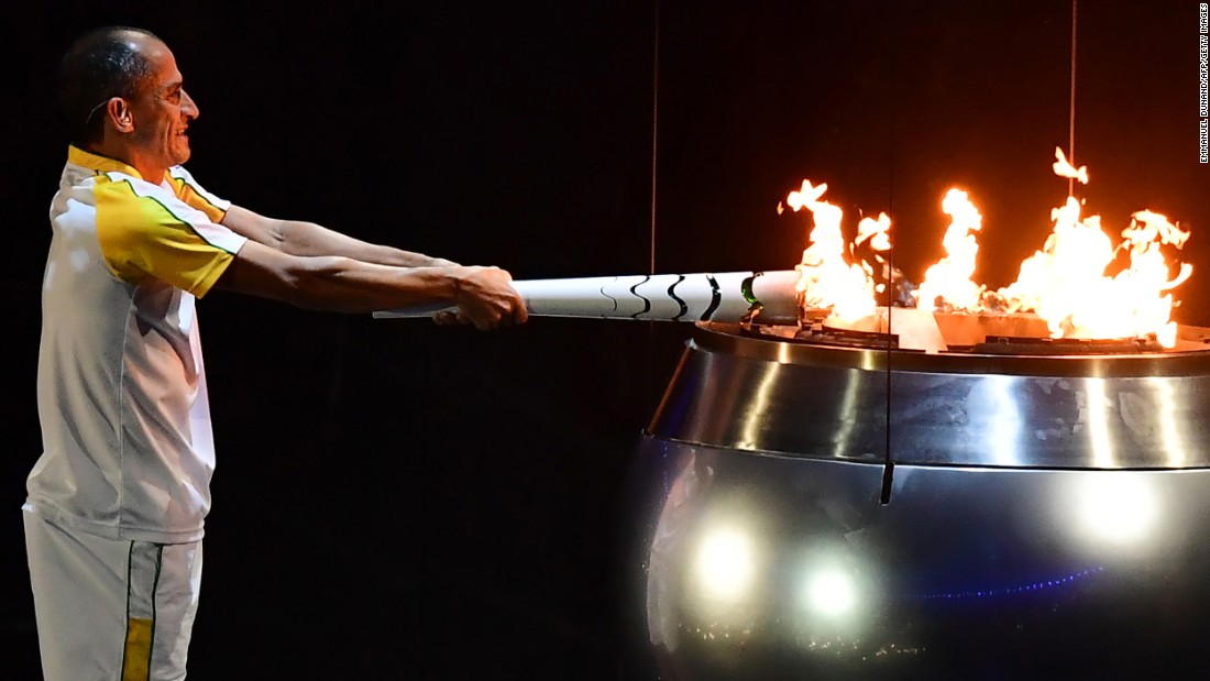 "Vanderlei Cordeiro de Lima, a former Brazilian long-distance runner, lights the Olympic cauldron during <a href=""http://www.cnn.com/2016/08/05/sport/gallery/olympics-opening-ceremony/index.html"" target=""_blank"">the opening ceremony</a> in Rio de Janeiro on Friday, August 5. De Lima was leading the Olympic marathon in 2004 when he was attacked by a protester near the end of the race. He ended up finishing third, but the graceful way he handled the disappointment won him plaudits around the world for his sportsmanship."