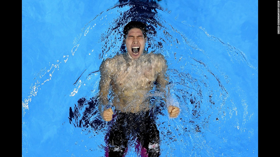 Japanese swimmer Kosuke Hagino celebrates in the pool after winning the 400-meter individual medley on Saturday, August 6.