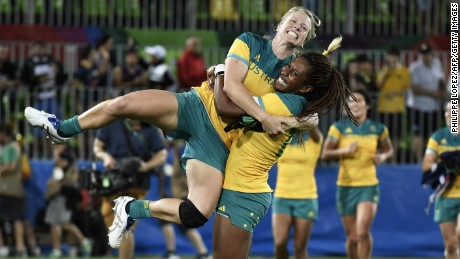 Australia's Ellia Green lifts up a teammate as they celebrate victory in the womens rugby sevens gold medal match with New Zealand.