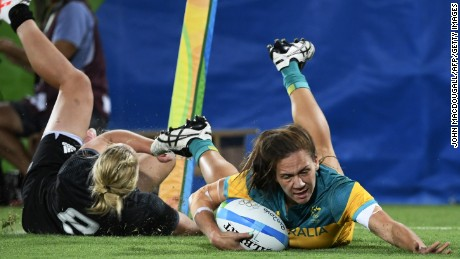 Australia's Evania Pelite scores a try in the womens rugby sevens gold medal match between New Zealand. Australia won the gold with the victory over New Zelaand.