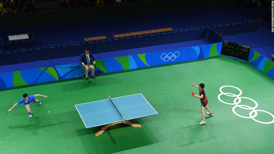 Hong Kong's Wong Chun Ting, left, plays Japan's Koki Niwa in table tennis. Niwa won to clinch a spot in the quarterfinals.