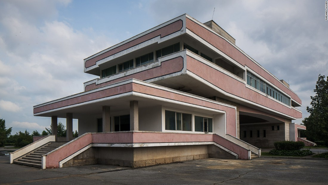 """A remote piece of modernist architecture used only as a quick stop for tourists on the way to visit the DMZ. It stays quiet most of the time with very little traffic passing through but has a warm presence of its own and sits with dignity in the empty landscape."""