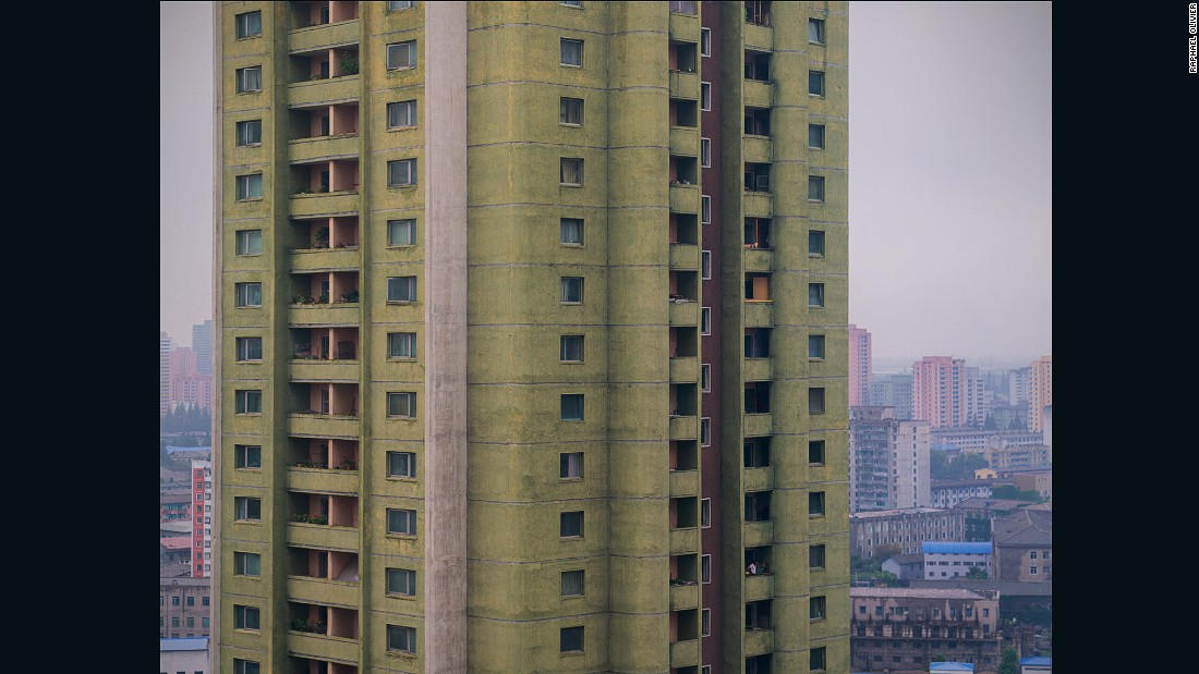 """A classical Pyongyang tower made with modernist round shapes, painted pistachio green with hints of salmon pink. It's perfectly in line with the pastel tones favored throughout the city."""