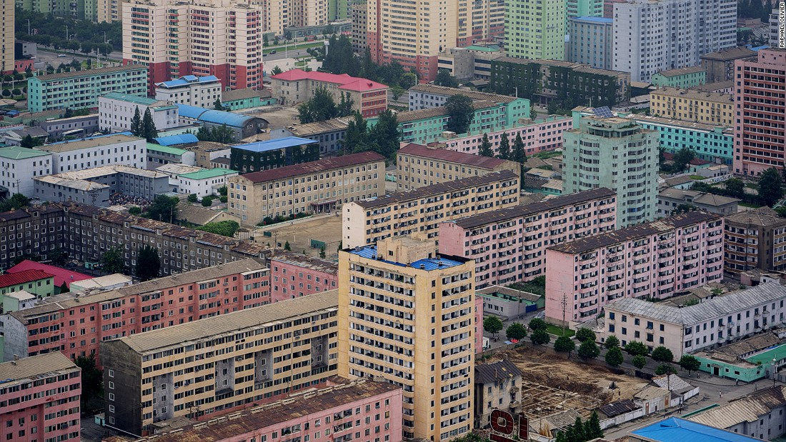 """A view of the capital's east seen from Juche Tower. Here the homogenous design of the city and absence of visual pollution from commercial advertising become apparent -- as well as the very linear and raw structures of most buildings."""
