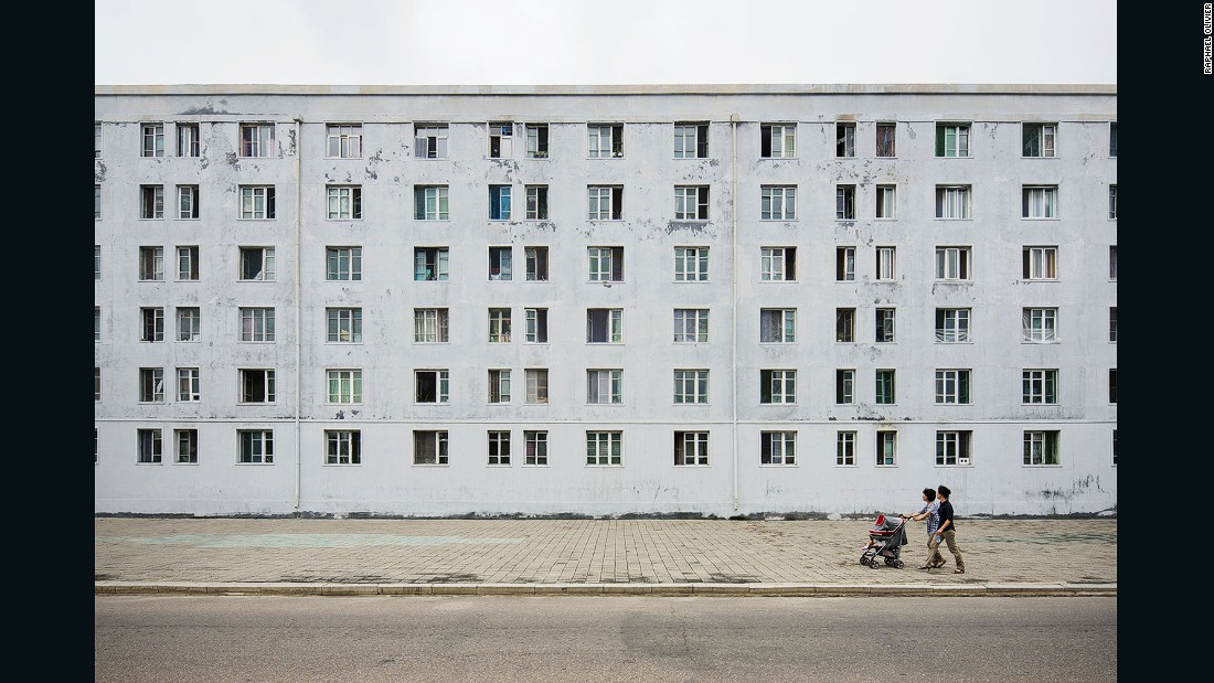 """The gray, minimal, and textured facade with grid-like windows was built by the Russians while helping North Korea to rebuild its capital after the Korean War.<strong> </strong>It seemingly has seen many winters, just like the people of this nation."""
