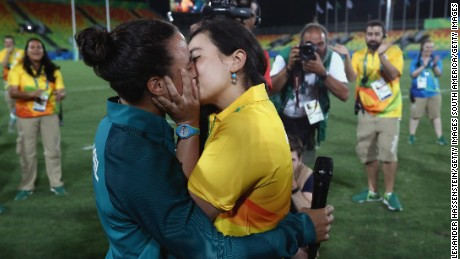 RIO DE JANEIRO, BRAZIL - AUGUST 08:  Volunteer Marjorie Enya (R) and rugby player Isadora Cerullo of Brazil kiss after proposing marriage after the Women's Gold Medal Rugby Sevens match between Australia and New Zealand on Day 3 of the Rio 2016 Olympic Games at the Deodoro Stadium on August 8, 2016 in Rio de Janeiro, Brazil.  (Photo by Alexander Hassenstein/Getty Images)